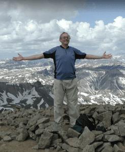 Chris up a mountain