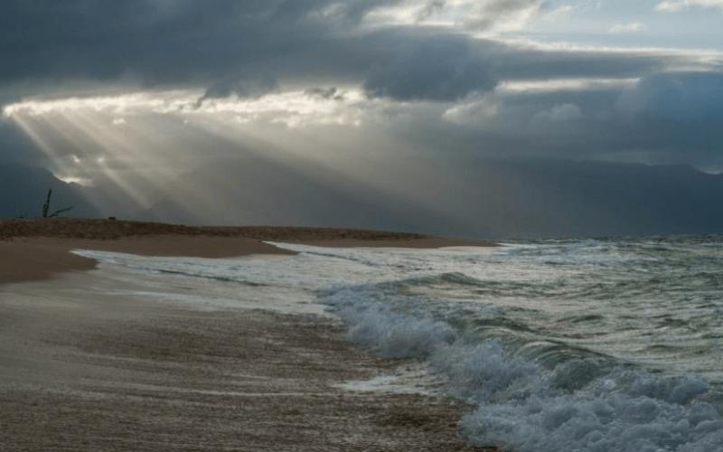 Ocean waves underneath cloud and sun rays for Gangaji website