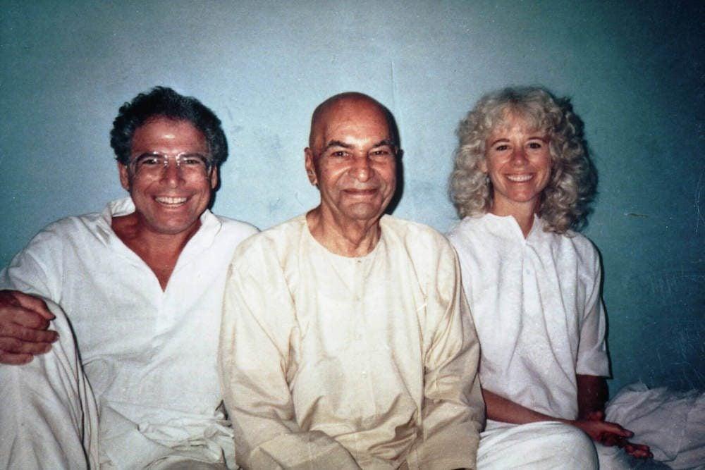 Eli and Gangaji sitting and smiling with Papaji in India