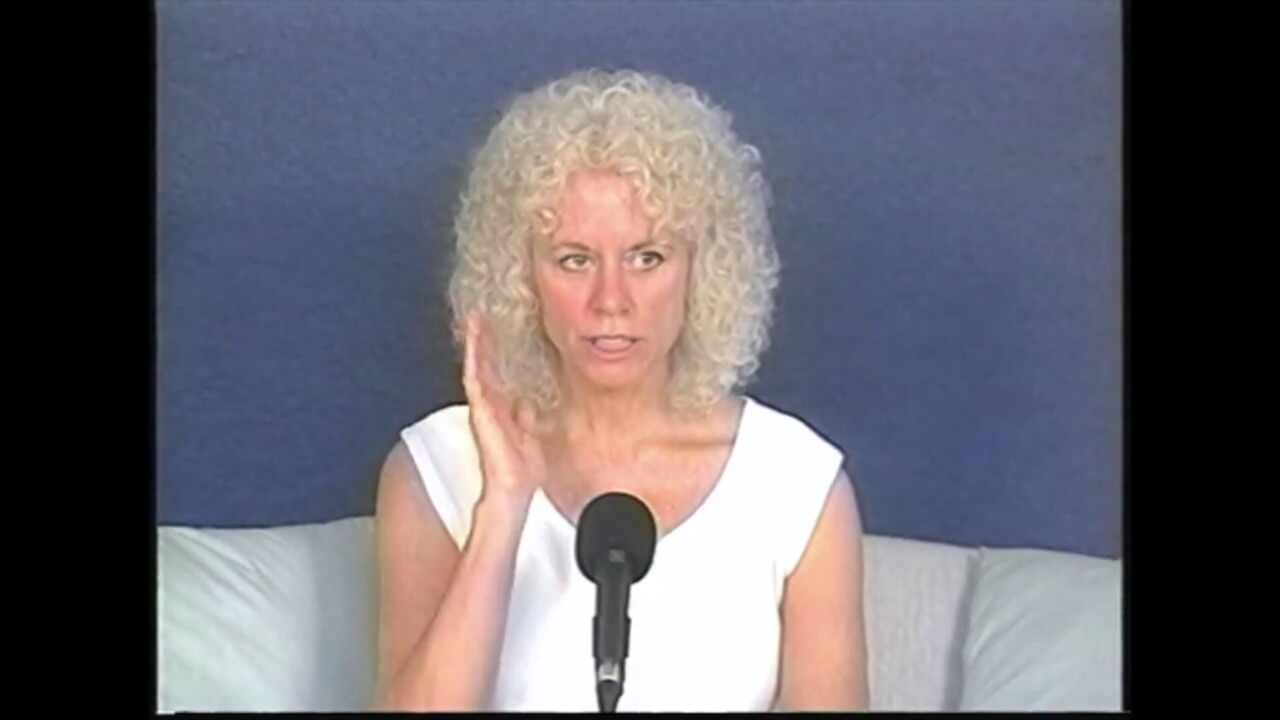 video- Gangaji curly hair hand raised